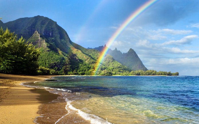 Rainbow over coastline, Haena Beach, Kauai, Hawaii, U.S.